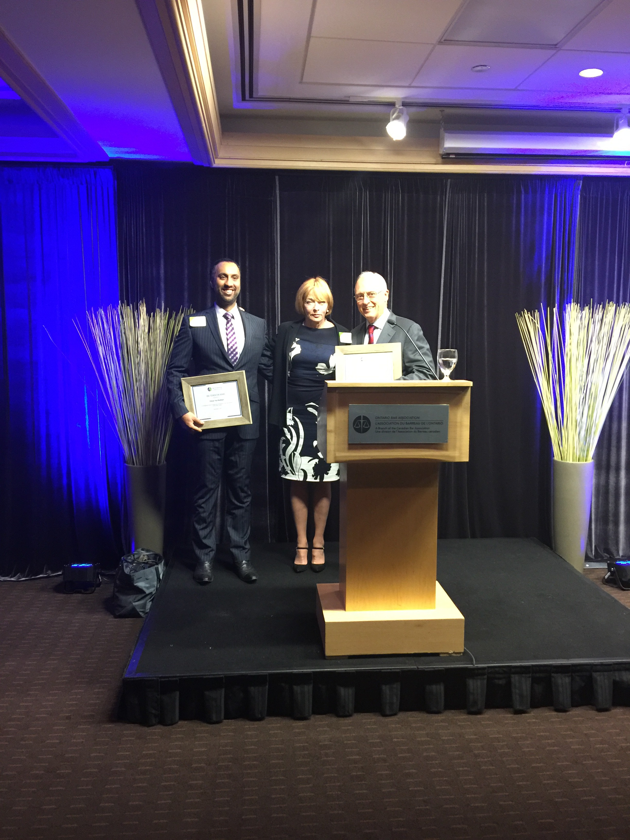 Recipients of the OBA Foundation Award, Omar Ha-Redeye (left), and Hon. Stephen Goudge (right), as presented by the Hon. Gloria Epstein.